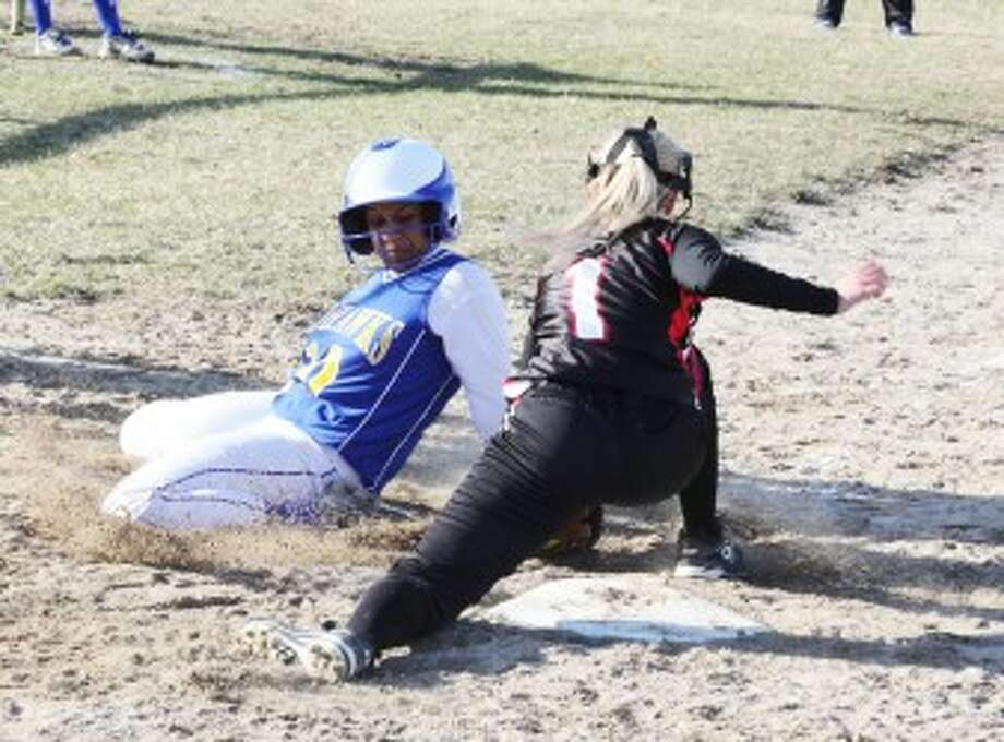 CLOSE CALL: Morley Stanwood's Brianna Wiersema (left) looks to avoid the tag from Reed City's Hanna Price during Tuesday's softball action at Morley Elementary. (Pioneer photo/Martin Slagter)