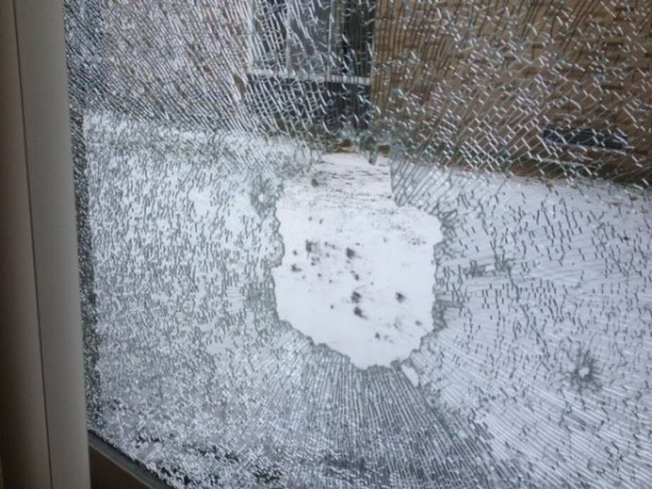 Four windows were shot out of Evart Elementary School during Thanksgiving break. Police are seeking information about the shooters. (Courtesy photo)