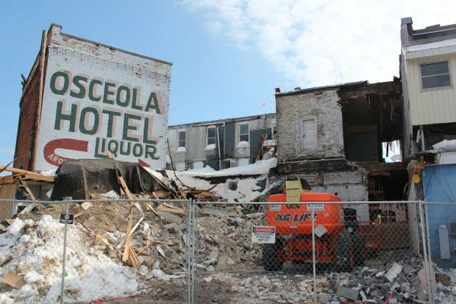 COMING DOWN: Demolition has begun on the Osceola Inn located on Upton Avenue in Reed City and will through the week. The building dates back to the late 1800s and the property is now owned by Yoplait. (Herald Review photos/Karin Armbruster and Justin McKee)