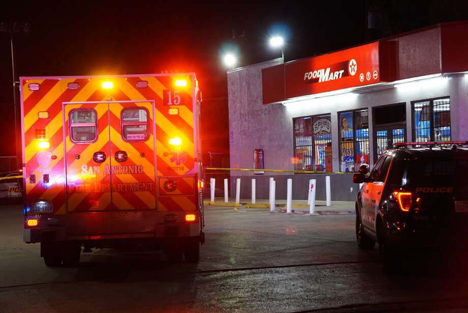 San Antonio Police examine the scene where a man in his late 20's was fatally shot in the parking lot of Texaco, 469 Castroville Road. Photo: Jacob Beltran