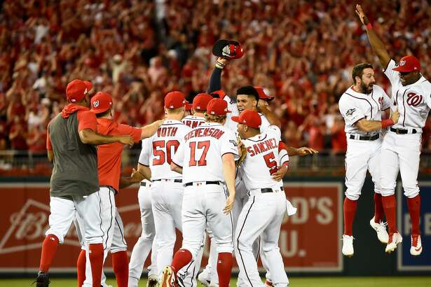 WASHINGTON, DC - OCTOBER 01: Juan Soto #22 of the Washington Nationals celebrates with his teammates after defeating the Milwaukee Brewers with a score 4 to 3 in the National League Wild Card game at Nationals Park on October 01, 2019 in Washington, DC. (Photo by Will Newton/Getty Images)