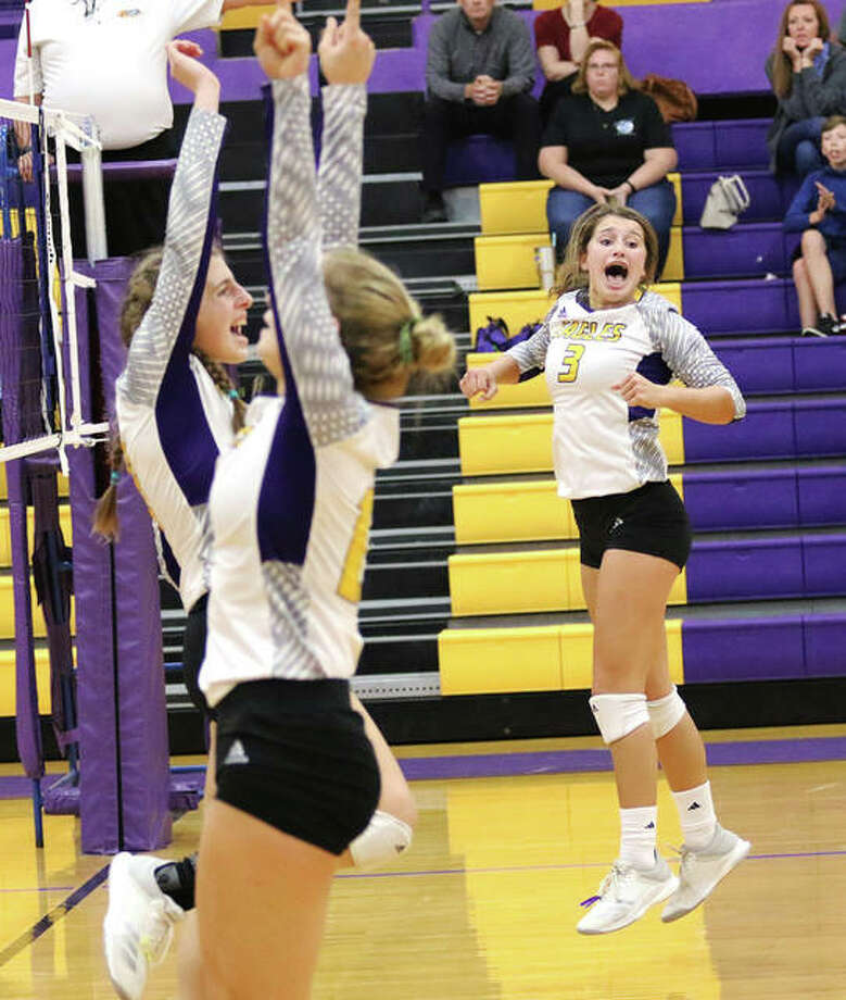 CM setter Maddie Brueckner (right) celebrates match point with attackers Jackie Woelfel (left) and Harper Buhs after a net violation on match point gives the Eagles a MVC victory over the rival Jersey Panthers on Tuesday night in Bethalto. Photo: Greg Shashack / The Telegraph
