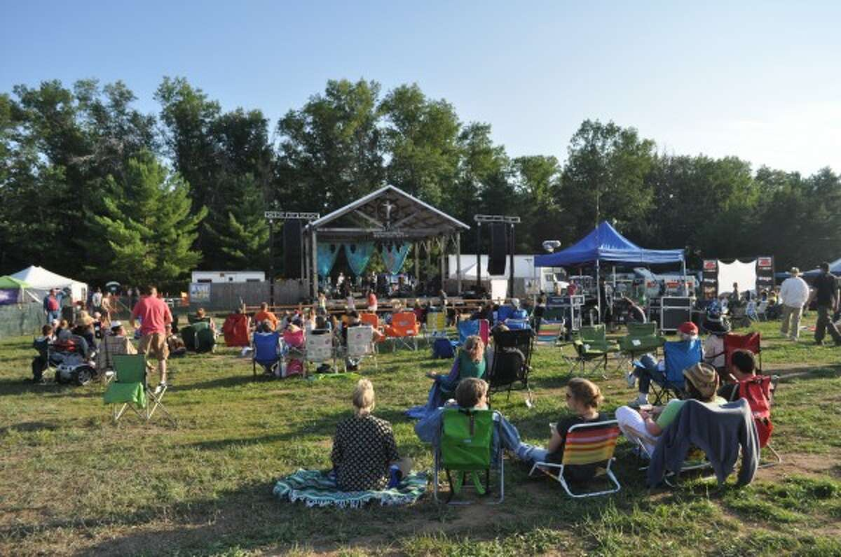 The 11th Hoxeyville Music Festival kicked off on Friday with performances from eight bands. Music continues through Sunday at the venue in the Manistee National Forest.