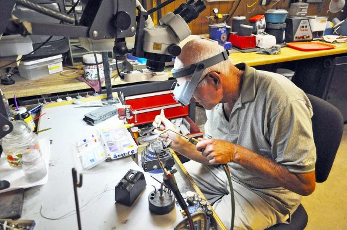 Gemologist Steve Blank works on a setting in a ring in his work room. Blank has been working with gems and jewelry for most of his life. (Eric Sagonowsky/News Advocate)