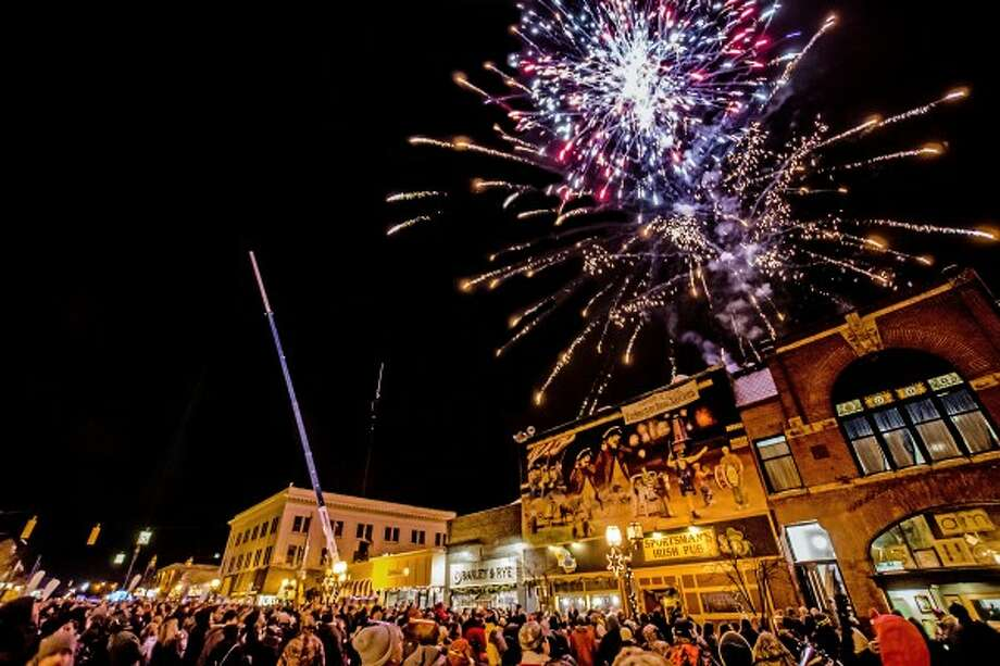 Fireworks explode over storefronts and the watching crowd on East Ludington Avenue in downtown Ludington on New Year's Eve. (Photo courtesy of Brad Reed)