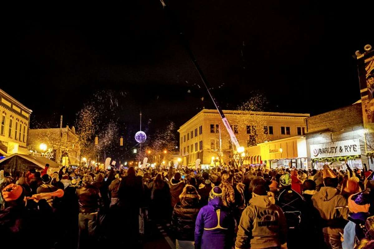 A crowd counts down to midnight and the beginning of 2014 in downtown Ludington on New Year's Eve. (Photo courtesy of Brad Reed)