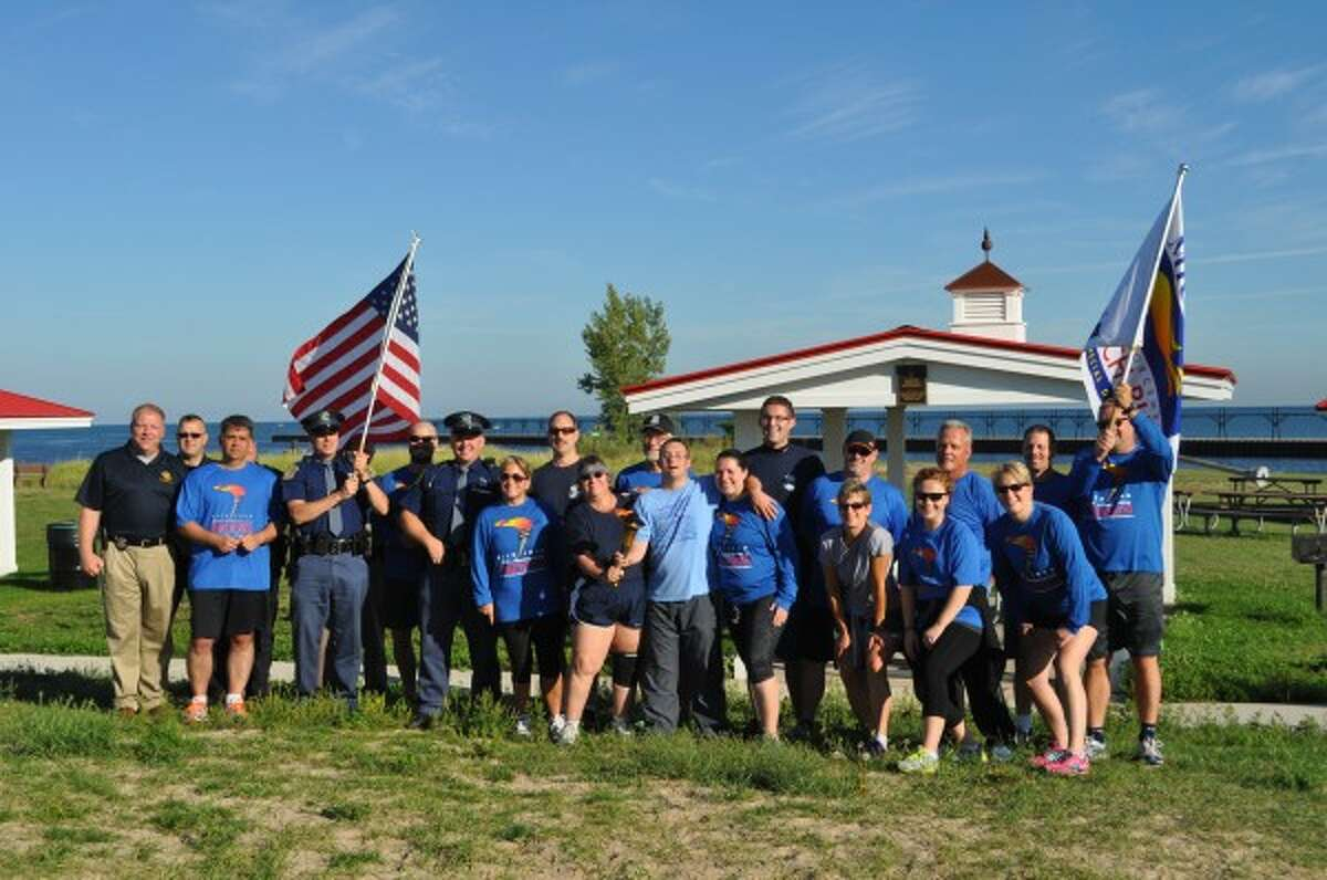 Several runners came together on Monday to support Special Olympics at a Manistee Community Run. The run ended with a celebration at the Lions Pavilion at First Street Beach.