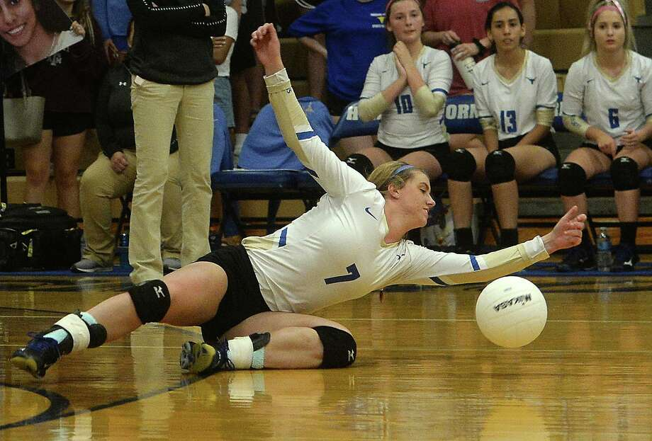 Hamshire - Fannett's Shawnee Craigen dives for the save on the volley with Lumberton during their match-up Tuesday at Hamshire - Fannett. Photo taken Tuesday, October 01, 2019 Kim Brent/The Enterprise Photo: Kim Brent / The Enterprise / BEN