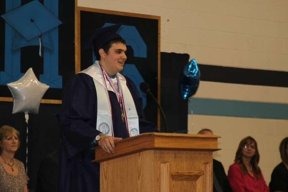 Senior class vice president Nathan Lee gives a farewell speech to the Brethren High School Class of 2014 at graduation on Friday. (Justine McGuire/News Advocate)