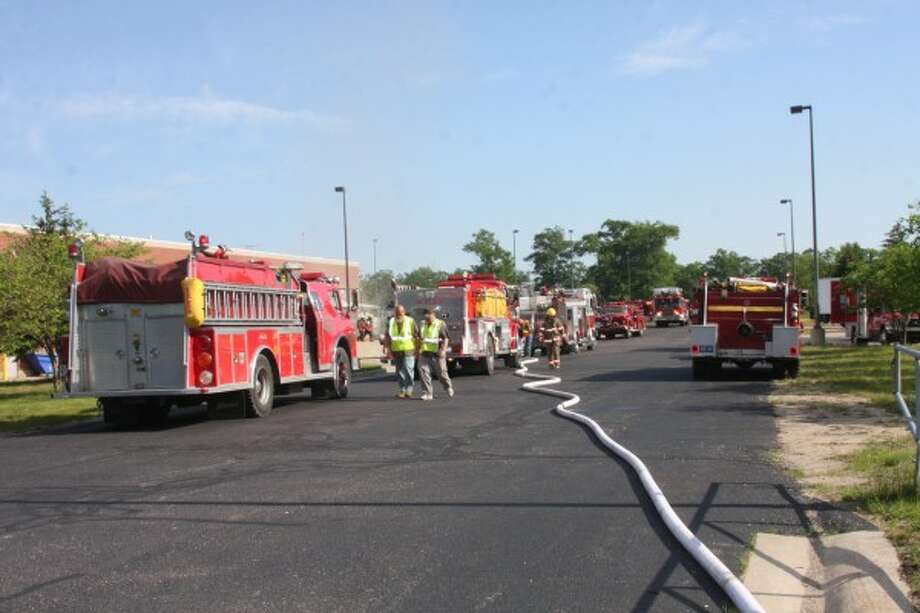 Fire trucks line the Pine Creek Road driveway of the Oaks Correctional Facility when a fire broke out in a warehouse on Tuesday evening. (Justine McGuire/News Advocate)