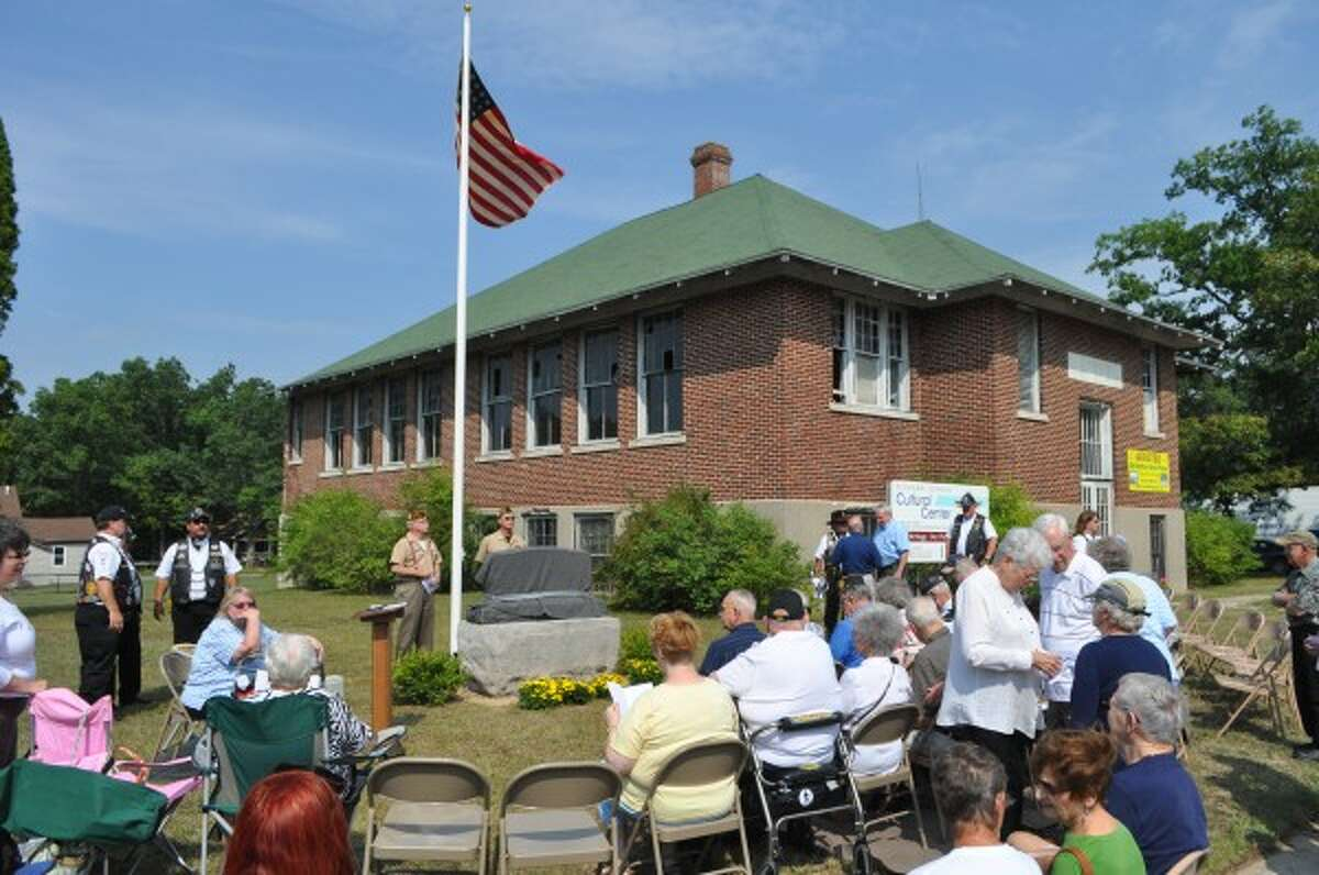 A crowd gathered in Brethren on Friday to honor area World War II veterans with the unveiling of a memorial.