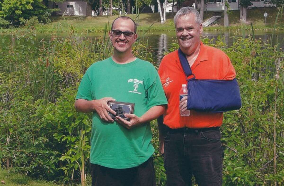 Gary Boerema presents Alfred Finner with an award for 2014 Area 24 Special Olympics Inspirational Athlete of the Year.