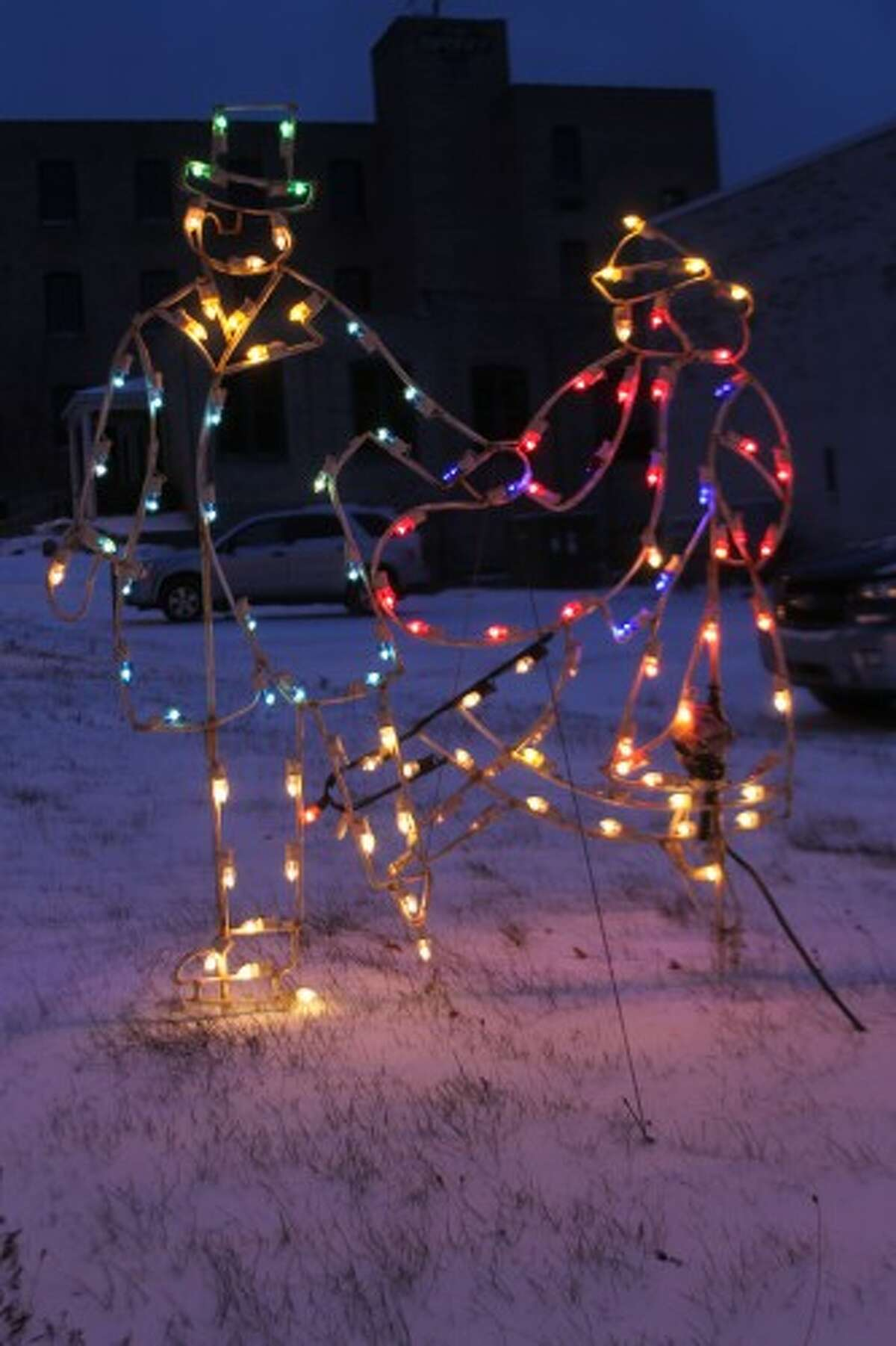 A dancing couple lights up the corner of River and Division streets. (Justine McGuire/News Advocate)
