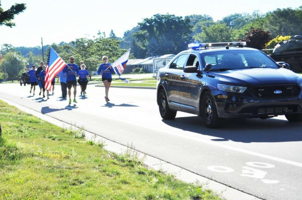 Manistee-area law enforcement agencies were present at a Manistee Community Run for Special Olympics on Monday in Manistee.