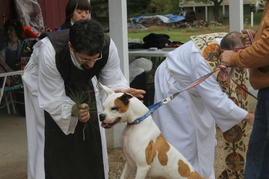 The Rev. Jon Pohl gives a blessing during the Blessing of the Animals in 2014. Circle Rocking S Children's Farm in Free Soil has hosted the event for 19 years. (Michelle Graves/News Advocate)