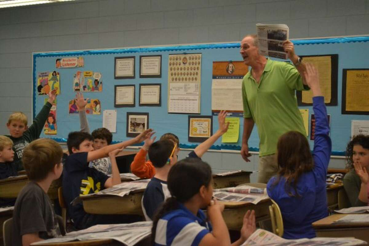 Students in Don Demeuse's fifth-grade class at Kennedy Elementary read the News Advocate regularly as part of the Newspapers in Education program in 2013. (File photo)