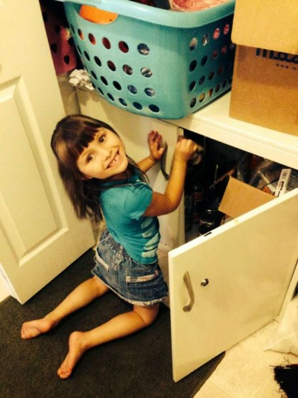 Mallory Kenny's daughter, Alexis Poynor, loves to help her mother out by organizing donations. (Courtesy photo)