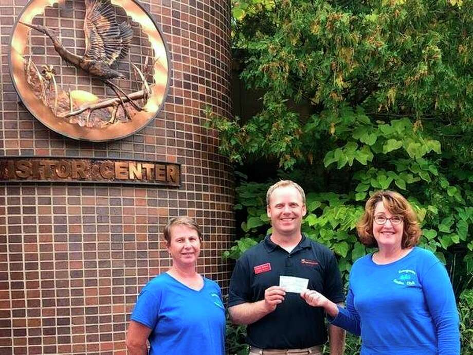 Marcia Doring (left), Evergreen Garden Club member, and Ellie Morse (right), president of Evergreen Garden Club, present Steve Frisbee (center), Nature Day Camp Director/Lead Educator, with a donation for $750. The money was raised by members of the Evergreen Garden Club through raffle basket donations to support Chippewa Nature Center camperships. (Photos provided)