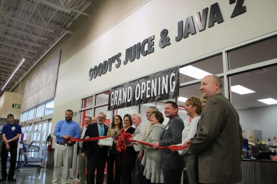 A group integral to the opening of Goody's Juice and Java 2 inside the Manistee Meijer poses during the ribbon cutting officially opening the new coffee shop on Thursday. (Justine McGuire/News Advocate)