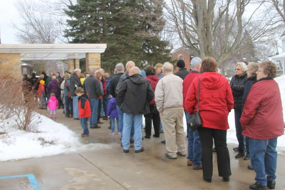 People line up outside Trinity Lutheran School during the Pork Roast and Sauerkraut Supper on Saturday in hopes of getting a taste of the famous meal. (Justine McGuire/News Advocate)