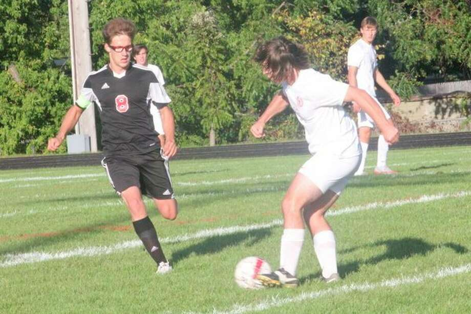 Reed City's Ty Brocker (8) goes after the ball against Big Rapids on Thursday. (Herald Review photo/John Raffel)