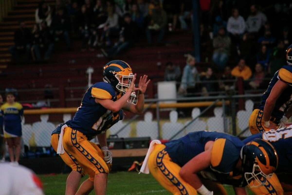 Evart quarterback Danny Witbeck gets ready to take the snap in recent action. (Herald Review/John Raffel)