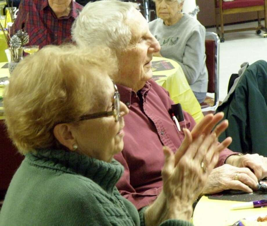 Jim Merriman and Betty Merriman applaud the merry music provided at the Manistee Senior Center Pre-New Years Eve party on Tuesday. (Courtesy photo/Jeanne Barber)