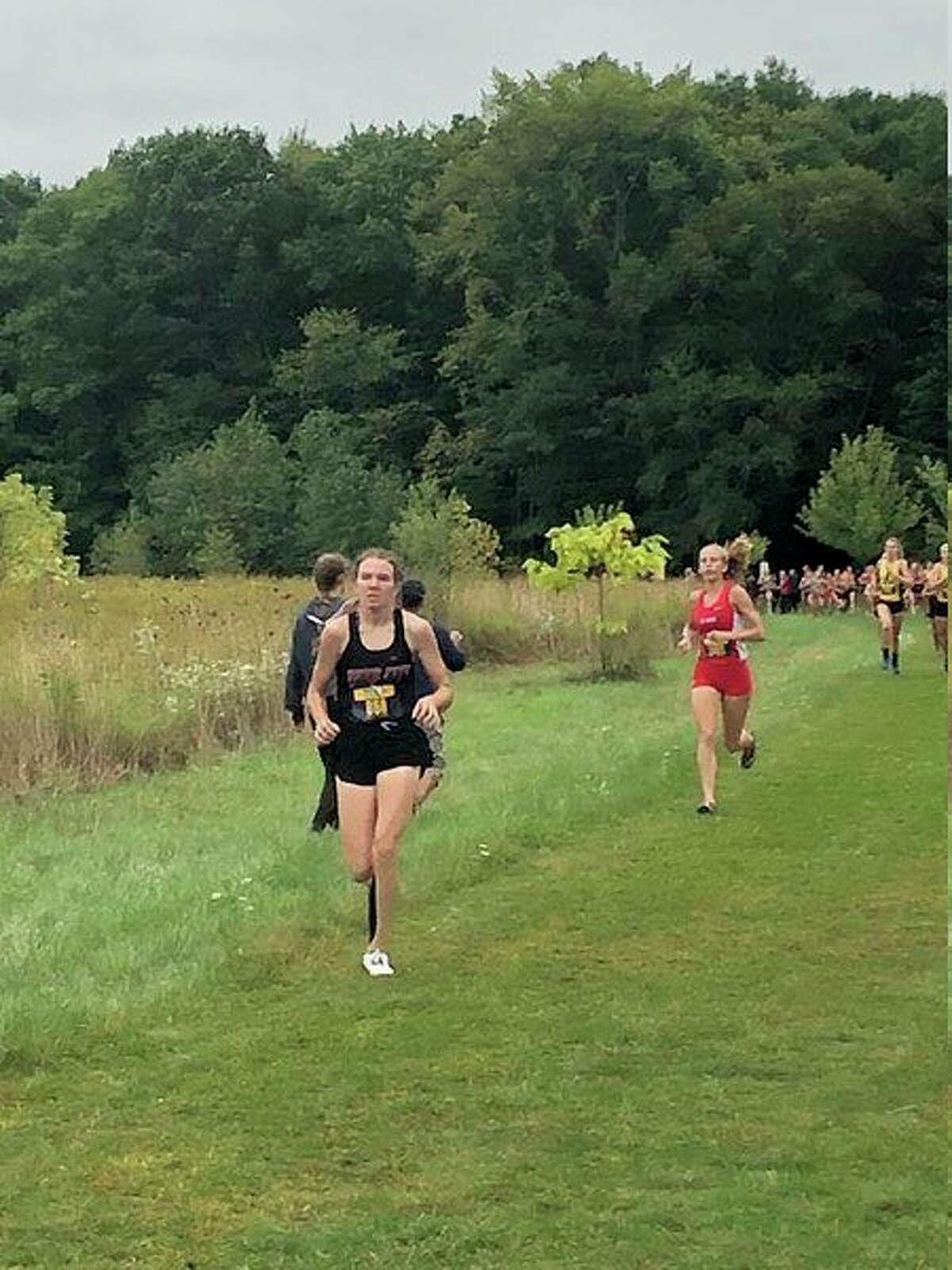 Abbi Kiaunis works her way through the course at Shepherd. (Herald Review photo)