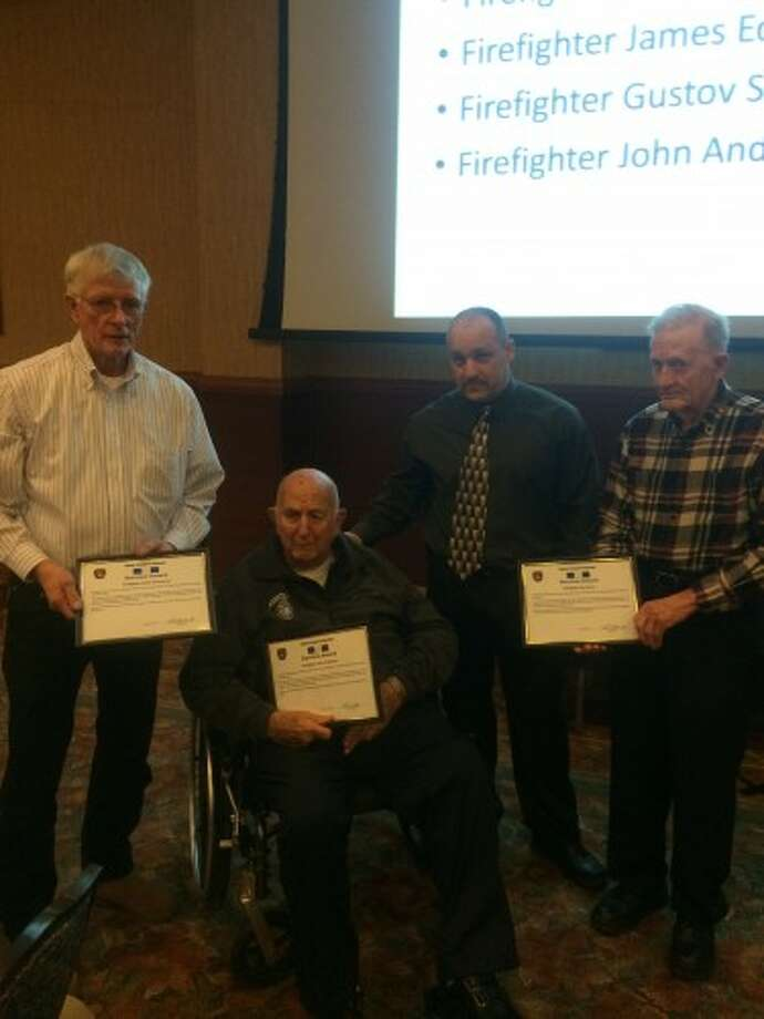 Firefighters John Anderson (retired), James Edmondson and Gus Storm (retired) receive Citation of Professional Excellence awards from the Manistee Township Fire Department along with Chief Charles Barron. (Courtesy photo)