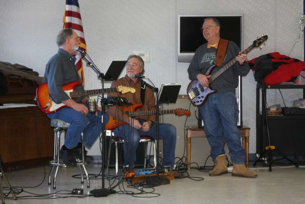Don Pelarski, Dave O'Brien and Dan Hogan, all of the D-Notes, take a brief interlude between songs at the Manistee Senior Center during Toe Tapping Tuesday this week. (Justine McGuire/News Advocate)