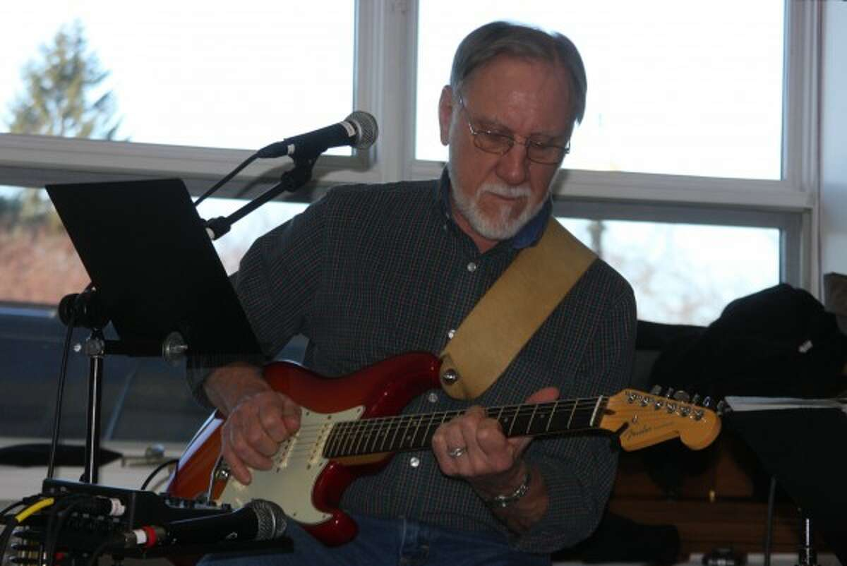 Don Pelarski, of the D-Notes, plays guitar during Toe Tapping Tuesday at the Manistee Senior Center this week. (Justine McGuire/News Advocate)