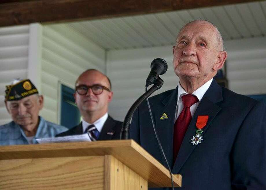 WWII veteran Jimmie H. Royer thanks everyone at the ceremony where Royer was awarded France's Legion of Honor at VFW Post 346 in Terre Haute, Ind., Sunday, Sept. 29, 2019. The 94-year-old World War II veteran from western Indiana received the medal Sunday for his wartime service. (Austen Leake/The Tribune-Star via AP) / The Tribune-Star