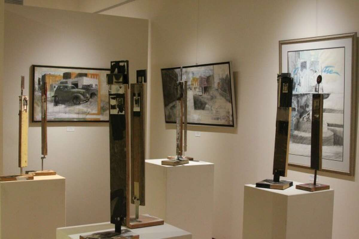 Photo by Sean Bradley / News Advocate The exhibit, featuring many of Cooper's works (pictured) from the past one or two years including paintings, is on display until Feb. 20 in the Manierre Dawson Gallery at West Shore Community College in Scottville.