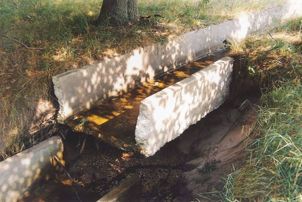The trough system at the outlet of the McGuineas drain is broken and worn away in some spots. (Courtesy photo)