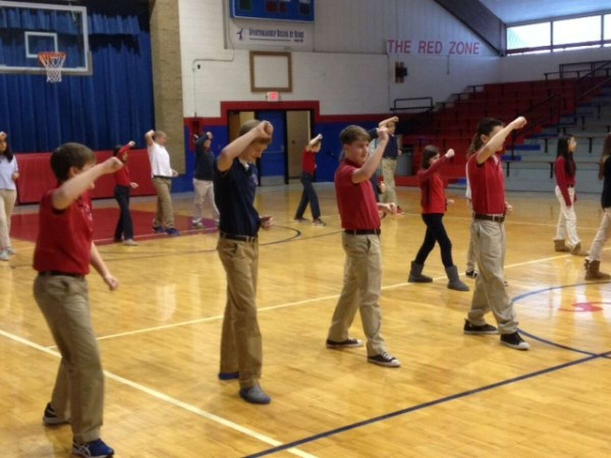 Manistee Catholic Central students practice martial arts moves in a physical education class. (Courtesy photo)