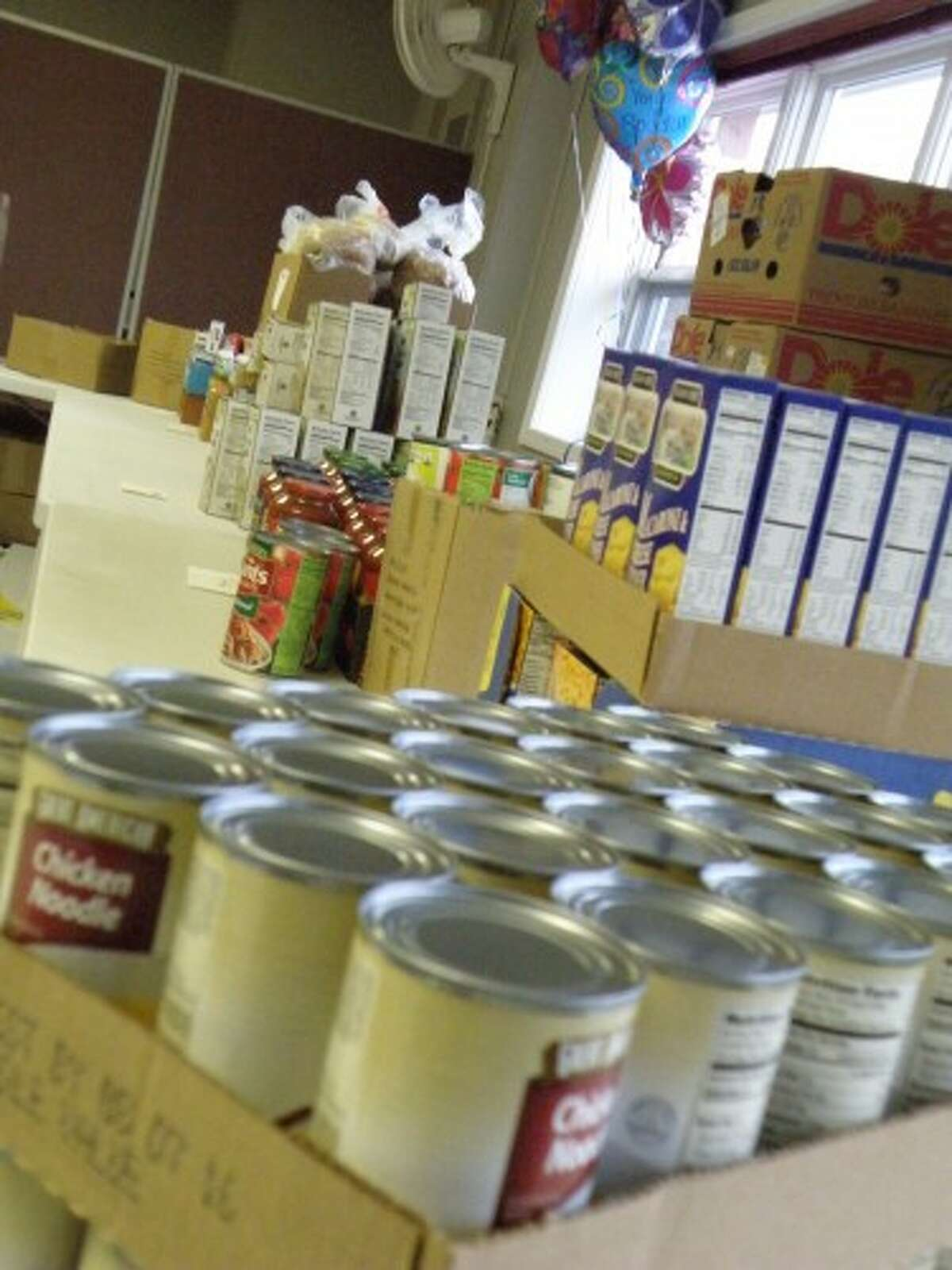 Manistee Senior Center volunteers set up for the monthly food pantry on Friday. (Courtesy photo)