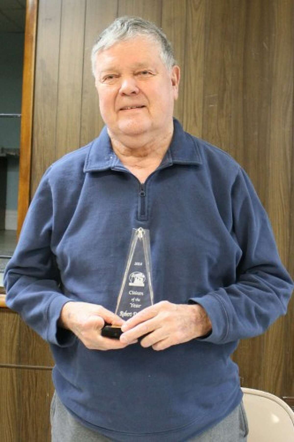 Bob DeYoung, 2014 Citizen of the Year, holds his award shortly after the announcement at the Eastlake Village Council meeting this month. (Justine McGuire/News Advocate)
