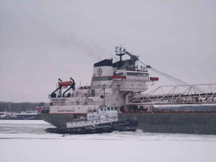 The tugboat Manitou broke ice along the Manistee River channel and into Manistee Lake, leading the way on Wednesday for the Manitowoc to take a shipment of coal to Morton Salt. (Ted Wagner/Courtesy photo)