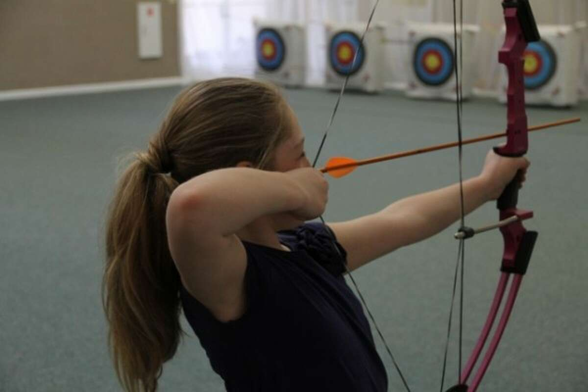 A Centershot participate pulls back a loaded bow during the program in 2013. (Courtesy photo)