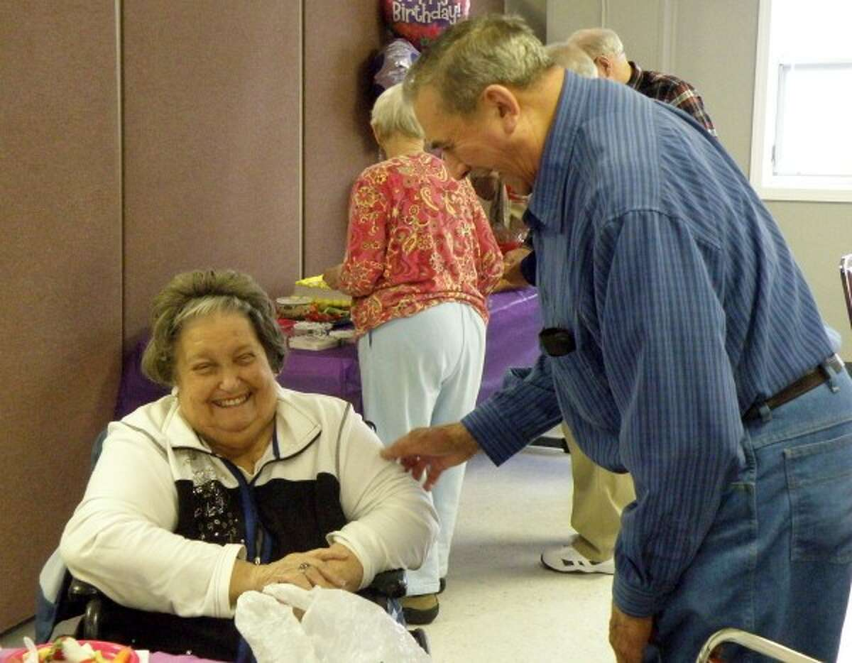 Harlan Kott congratulates Phyllis Sheras during her 90th birthday party at the Manistee Senior Center. (Jeanne Barber/Courtesy photo)