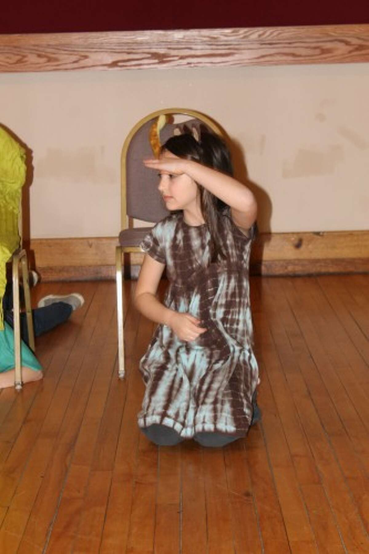 """Natalie Alden plays the chihuahua in the Youth Theater Workshop's performance of """"Why the Chihuahua Lives Indoors"""" during the Arts and Culture Alliance's IceBreaker on Saturday at the Ramsdell Theatre. (Justine McGuire/News Advocate)"""