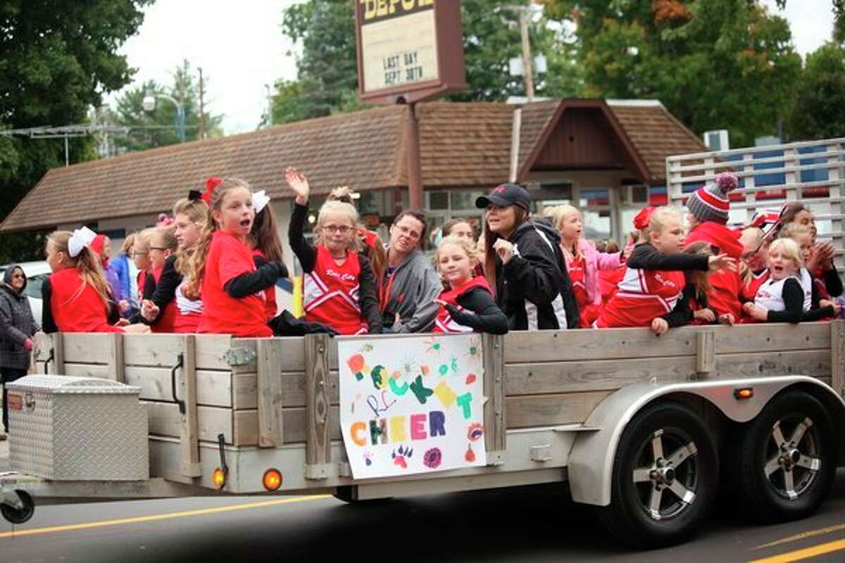 Cheerleaders ride past in their float at last year's RCAPS homecoming parade. This year,both EPS and RCAPS will have their parades on Friday, Oct. 11. (Herald Review file photo)