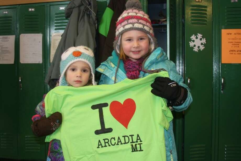 "Sisters Emma and Anna Bradford pose with an ""I love Arcadia"" t-shirt at the Arcadia Fire and Ice Festival on Saturday."
