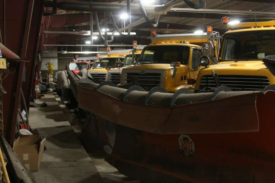Plow trucks at the City of Manistee Department of Public Works were deployed Monday afternoon once a winter storm hit Manistee and other parts of Northern Michigan. (Sean Bradley/News Advocate)