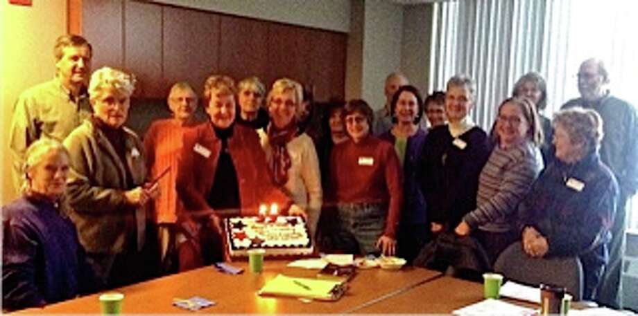 Nineteen members of the League of Women Voters Manistee County gathered on Thursday around the anniversary cake to celebrate the founding of the LWV on Feb.14, 1920, by Carrie Chapman Catt. (Courtesy photo)