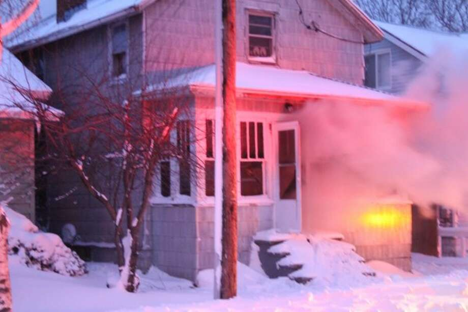 A home on the 100 block of Hancock Street in Manistee caught on fire late Thursday. The official cause of the fire and whether or not anyone was hurt was unknown as of press time. Stay with the News Advocate as more information becomes available. (Sean Bradley/News Advocate)