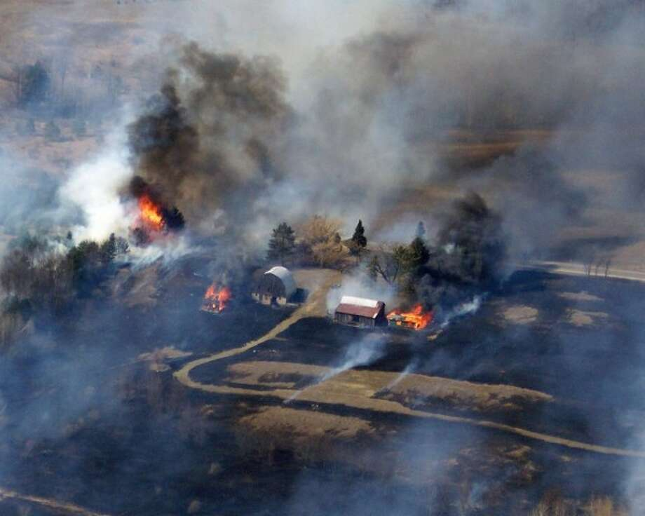 A wildfire burns 140 acres around Hoxeyville in 2008. This photo was taken from a U.S. Forest Service helicopter. (Courtesy photo)