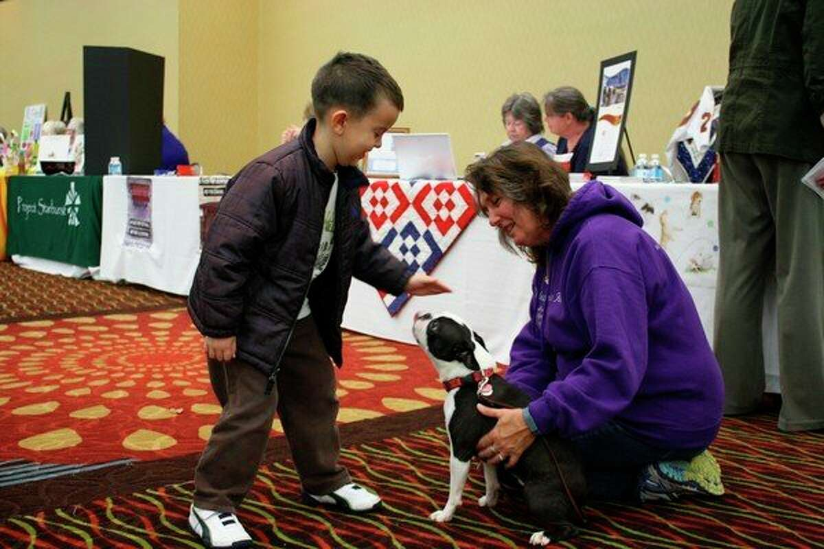 In addition to assisting residents and pets in Mecosta, Osceola and Lake counties, the volunteers with the Riley MacKenzie Fund attend area schools and events with dogs to teach people how to take care of and interact with pets. People can show their support to the organization on Oct. 5 at the Riley MacKenzie Fund 10th Anniversary Fundraiser. (Herald Review file photo)