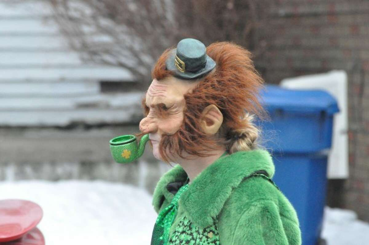 A leprechaun walks in the annual Manistee Wee Parade in 2014. (file photo)