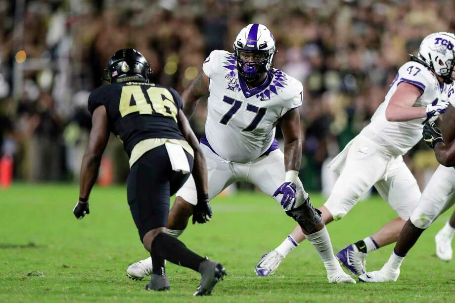 TCU offensive tackle Lucas Niang (77) plays against Purdue during the second half of an NCAA college football game in West Lafayette, Ind., on Sept. 14. Photo: Michael Conroy / Associated Press / Copyright 2019 The Associated Press. All rights reserved.